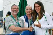 16 August 2016; Annalise Murphy of Ireland with Kieran Mulvey, left, Chairman, Sport Ireland and John Treacy, CEO, Sport Ireland, after she won silver in the Women's Laser Radial Medal race on the Pão de Açúcar course, Copacabana, during the 2016 Rio Summer Olympic Games in Rio de Janeiro, Brazil. Photo by Brendan Moran/Sportsfile