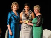 6 November 2010; Mags D'Arcy, Wexford, is presented with her 2010 Camogie All-Star award by President Mary McAleese and President of the Camogie Association Joan O' Flynn at the 2010 Camogie All-Stars in association with O'Neills. Citywest Hotel, Saggart, Co. Dublin. Picture credit: Stephen McCarthy / SPORTSFILE