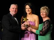 6 November 2010; Aisling Dunphy, Kilkenny, is presented with her 2010 Camogie Leinster Young Player of the Year award by President of the Camogie Association Joan O' Flynn and Cormac Farrell, Marketing Director, O'Neills, at the 2010 Camogie All-Stars in association with O'Neills. Citywest Hotel, Saggart, Co. Dublin. Picture credit: Stephen McCarthy / SPORTSFILE