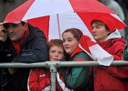 7 November 2010; Spectators shelter from the heavy rain during the game. AIB GAA Football Connacht Club Senior Championship Semi-Final, Killererin v Ballintubber, Tuam Stadium, Tuam, Co. Galway. Picture credit: David Maher / SPORTSFILE