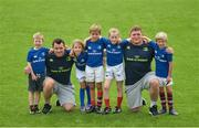 17 August 2016; Leinster Rugby players Cian Healy and Tadhg Furlong with young participants, from left to right, Cian Foley, age 6, from Artane, Dublin, Caoimhe Heenahan, age 6, from Clontarf, Dublin, Mathew Bryans, age 8, from Contarf, Dublin, Cathrine Coll, age 8, from Drumcondra, Dublin and   Rubin Bulger, age 6, from Clontarf, Dublin at the Bank of Ireland Leinster Rugby Camp at Clontarf FC, Castle Avenue, Clontarf, Dublin. Photo by Eóin Noonan/Sportsfile