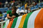 18 August 2016; Team Ireland silver medallist in rowing Gary O'Donovan affixes a tri-colour ahead of the Men's 400m hurdles final in the Olympic Stadium, Maracanã, during the 2016 Rio Summer Olympic Games in Rio de Janeiro, Brazil. Photo by Brendan Moran/Sportsfile