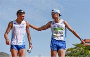 19 August 2016; Aleksi Ojala of Finland is consoled by fellow Finnish competitor Jarkko Kinnunen after being disqualified during the Men's 50km Walk Final during the 2016 Rio Summer Olympic Games in Rio de Janeiro, Brazil. Photo by Stephen McCarthy/Sportsfile