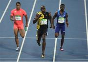 19 August 2016; Usain Bolt of Jamaica leads Trayvon Bromell, right, of USA and Aska Cambridge of Japan, left, on his way to winning the Men's 4 x 100m relay final in the Olympic Stadium, Maracanã, during the 2016 Rio Summer Olympic Games in Rio de Janeiro, Brazil. Photo by Brendan Moran/Sportsfile