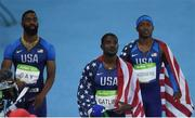 19 August 2016; Team USA, from left, Tyson Gay, Justin Gatlin and Mike Rodgers look up at the screen and realise they were disqualified from the Men's 4 x 100m relay final in the Olympic Stadium, Maracanã, during the 2016 Rio Summer Olympic Games in Rio de Janeiro, Brazil. Photo by Brendan Moran/Sportsfile