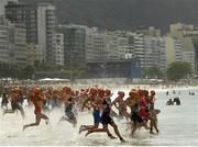 20 August 2016; Competitors enter the water at the start of the Women's Triathlon at Fort Copacobana during the 2016 Rio Summer Olympic Games in Rio de Janeiro, Brazil. Photo by Ramsey Cardy/Sportsfile
