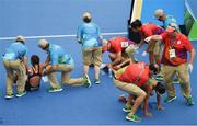 20 August 2016; Competitors are helped to their feet following the Women's Triathlon at Fort Copacobana during the 2016 Rio Summer Olympic Games in Rio de Janeiro, Brazil. Photo by Ramsey Cardy/Sportsfile