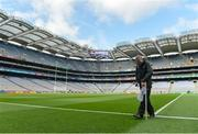 21 August 2016; groundskeeper Pauric Green erects a flag before the GAA Football All-Ireland Senior Championship Semi-Final game between Mayo and Tipperary at Croke Park in Dublin. Photo by Eóin Noonan/Sportsfile