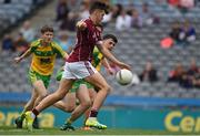 21 August 2016; Robert Finnerty of Galway shoots past Aaron McCrea of Donegal to score a goal in the 5th minute during the Electric Ireland GAA Football All-Ireland Minor Championship Semi-Final game between Donegal and Galway at Croke Park in Dublin. Photo by Ray McManus/Sportsfile