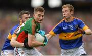 21 August 2016; Conor O'Shea of Mayo in action against Ciarán Kenrick, left and Brian Fox, right of Tipperary during the GAA Football All-Ireland Senior Championship Semi-Final game between Mayo and Tipperary at Croke Park in Dublin. Photo by Eóin Noonan/Sportsfile