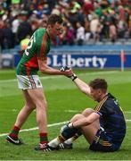 21 August 2016; Tipperary goalkeeper Evan Comerford is helped to his feet by Mayo's Diarmuid O'Connor after the GAA Football All-Ireland Senior Championship Semi-Final game between Tipperary and Mayo at Croke Park in Dublin. Photo by Ray McManus/Sportsfile