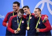 7 August 2016; Team USA, from left, Nathan Adrian, Ryan Held, Michael Phelps and Caeleb Dressel with their gold medals after they won the Men's 4 x 100m Freestyle Relay at the Olympic Aquatic Stadium during the 2016 Rio Summer Olympic Games in Rio de Janeiro, Brazil. Photo by Stephen McCarthy/Sportsfile