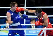 11 August 2016; Steven Donnelly of Ireland, left, in action against Tuvshinbat Byamba of Mongolia during their Welterweight preliminary round of 16 bout in the Riocentro Pavillion 6 Arena, Barra da Tijuca, during the 2016 Rio Summer Olympic Games in Rio de Janeiro, Brazil. Photo by Ramsey Cardy/Sportsfile