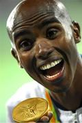 13 August 2016; Mo Farah of Great Britain with his gold medal for the Men's 10000m in the Olympic Stadium, Maracanã, during the 2016 Rio Summer Olympic Games in Rio de Janeiro, Brazil. Photo by Brendan Moran/Sportsfile