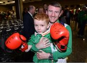 24 August 2016; Boxer Paddy Barnes with Joel Thomas, age 5, from Baldoyle, Co Dublin, at Dublin Airport as Team Ireland arrive home from the Games of the XXXI Olympiad at Dublin Airport in Dublin. Photo by Seb Daly/Sportsfile