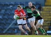 21 November 2010; John Hearne, Stradbally, in action against Sean O'Brien, 14, and Barry O'Driscoll, Nemo Rangers. AIB GAA Football Munster Club Senior Championship Semi-Final, Nemo Rangers v Stradbally, Pairc Ui Rinn, Cork. Picture credit: Brendan Moran / SPORTSFILE