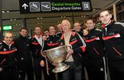 24 November 2010; Cork manager Conor Counihan and Cork players, from left, John Miskella, Alan Quirke, Nicholas Murphy, Donncha O'Connor, Aidan Walsh, Pearse O'Neill, Paudie Kissane, Paul Kerrigan, and Daniel Goulding, with the Sam Maguire cup, prior to departure for Kuala Lumpur ahead of the 2010 GAA Football All-Stars Tour, sponsored by Vodafone. Dublin Airport, Dublin. Picture credit: Brian Lawless / SPORTSFILE