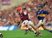 9 September 2001; Ollie Canning, Galway, breaks through Tipperary's Mark O'Leary and Eoin Kelly, right. Tipperary v Galway, All Ireland Senior Hurling Final, Croke Park, Dublin. Picture credit; Brendan Moran / SPORTSFILE