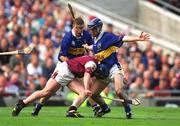 9 September 2001; Liam Hodgins, Galway, is blocked by Tipperary's Eoin Kelly. Tipperary v Galway, All Ireland Senior Hurling Final, Croke Park, Dublin. Picture credit; Damien Eagers / SPORTSFILE