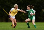 4 September 2016; Helen Hughes of London in action against Áine Tubridy of Antrim during the TG4 All Ireland Junior Football Championship Semi Final between Antrim and London in Fingallians, Dublin.  Photo by Sam Barnes/Sportsfile