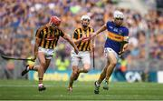 4 September 2016; Niall O'Meara of Tipperary races clear of Cillian Buckley, left, and Lester Ryan of Kilkenny during the GAA Hurling All-Ireland Senior Championship Final match between Kilkenny and Tipperary at Croke Park in Dublin. Photo by Brendan Moran/Sportsfile