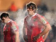 18 December 2010; Donncha O'Callaghan and David Wallace, left, Munster, during the game. Heineken Cup, Pool 3, Round 4, Ospreys v Munster, Liberty Stadium, Swansea, Wales. Picture credit: Stephen McCarthy / SPORTSFILE