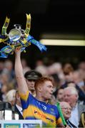 4 September 2016; Jason Forde of Tipperary lifts the trophy following his team's victory in the GAA Hurling All-Ireland Senior Championship Final match between Kilkenny and Tipperary at Croke Park in Dublin. Photo by Seb Daly/Sportsfile