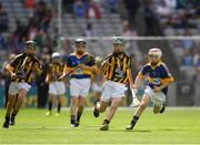 4 September 2016; Mark Holohan, Scoil Naomh Feichin, Termonfechin, Louth, representing Kilkenny, in action against Eamon Cassidy, St Brigids, Maghera, Derry, representing Tipperary,  during the Go Games during the GAA Hurling All-Ireland Senior Championship Final match between Kilkenny and Tipperary at Croke Park in Dublin. Photo by Ray McManus/Sportsfile