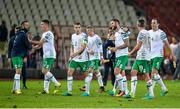 5 September 2016; Daryl Murphy of Republic of Ireland, centre, is congratulated by team mate Wes Hoolahan as the team make their way off the field following the FIFA World Cup Qualifier match between Serbia and Republic of Ireland at the Red Star Stadium in Belgrade, Serbia. Photo by Alex Nicodim/Sportsfile