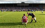 10 September 2016; Linesman Johnny Ryan sympathies with Fintan Burke of Galway after the Bord Gáis Energy GAA Hurling All-Ireland U21 Championship Final match between Galway and Waterford at Semple Stadium in Thurles, Co Tipperary. Photo by Ray McManus/Sportsfile