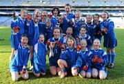 11 January 2011; The girls from Guardian Angels National School, Blackrock, celebrate with the trophy and their medals after winning the Corn Irish Rubies. Allianz Cumann na mBunscol Football Finals, Corn Irish Rubies, Scoil Bhríde, Glasnevin, Dublin v Guardian Angels National School, Blackrock, Dublin. Croke Park, Dublin. Picture credit: Brendan Moran / SPORTSFILE