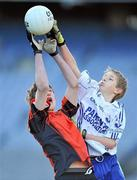 11 January 2011; Conor Kearns, right, Bishop Galvin National School, Templeogue, contests a high ball with Conor Ryan, St Brigid's, Killester. Allianz Cumann na mBunscol Football Finals, Sciath na nGearaltach, St Brigid's, Killester, Dublin v Bishop Galvin National School, Templeogue, Dublin. Croke Park, Dublin. Picture credit: Brendan Moran / SPORTSFILE