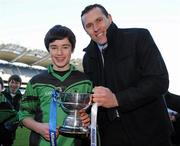 11 January 2011; St. Josephs BNS capatin Jack McVeigh, is presented with Corn na nGearaltach by former Dublin footballer and Allianz Ciaran Whelan. Allianz Cumann na mBunscol Football Finals, Corn na nGearaltach, St. Pius X BNS, Terenure v St. Josephs BNS, Terenure. Croke Park, Dublin. Picture credit: Barry Cregg / SPORTSFILE