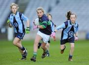 11 January 2011; Rebecca Candon, centre, Scoil Loreto, Rathfarnham, in action against Alice Eaton, left, and Lasairíona Huggard, Scoil Lorcáin, Monkstown. Allianz Cumann na mBunscol Football Finals, Corn Comhar Linn, Scoil Lorcáin, Monkstown, Dublin v Scoil Loreto, Rathfarnham, Dublin. Croke Park, Dublin. Picture credit: Barry Cregg / SPORTSFILE