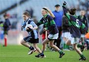 11 January 2011; Sinéad Wylde, left, Scoil Lorcáin, Monkstown, in action against Emma O'Brien, right, and Kate Moore, Scoil Loreto, Rathfarnham. Allianz Cumann na mBunscol Football Finals, Corn Comhar Linn, Scoil Lorcáin, Monkstown, Dublin v Scoil Loreto, Rathfarnham, Dublin. Croke Park, Dublin. Picture credit: Barry Cregg / SPORTSFILE