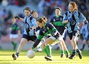 11 January 2011; Laura Nagle, Scoil Loreto, Rathfarnham, in action against Sinéad Wylde, left, and Clíona Ní Dhornáin, Scoil Lorcáin, Monkstown. Allianz Cumann na mBunscol Football Finals, Corn Comhar Linn, Scoil Lorcáin, Monkstown, Dublin v Scoil Loreto, Rathfarnham, Dublin. Croke Park, Dublin. Picture credit: Barry Cregg / SPORTSFILE