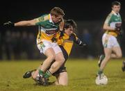 12 January 2011; David Kinnan, DCU, in action against Sean Ryan, Offaly. O'Byrne Cup, Offaly v DCU, Rhode, Co. Offaly. Picture credit: Brian Lawless / SPORTSFILE
