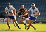 10 September 2016; Míchéal Harney of Waterford in action against Bord Gáis Energy Ambassador Conor Whelan of Galway during the Bord Gáis Energy GAA Hurling All-Ireland U21 Championship Final match between Galway and Waterford at Semple Stadium in Thurles, Co Tipperary. Photo by Brendan Moran/Sportsfile