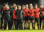 15 January 2011; Down manager James McCartan, sixth from left, and his players observe a minute's silence for the late Michaela McAreavey. Barrett Sports Lighting Dr. McKenna Cup, Section C, Down v Armagh, Pairc Esler, Newry, Co. Down. Picture credit: Oliver McVeigh / SPORTSFILE