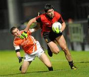 15 January 2011; Kieran Anderson, Down, in action against Anto Duffy, Armagh. Barrett Sports Lighting Dr. McKenna Cup, Section C, Down v Armagh, Pairc Esler, Newry, Co. Down. Picture credit: Oliver McVeigh / SPORTSFILE