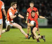 15 January 2011; Ronan Murtagh, Down, in action against Kieran Toner, Armagh. Barrett Sports Lighting Dr. McKenna Cup, Section C, Down v Armagh, Pairc Esler, Newry, Co. Down. Picture credit: Oliver McVeigh / SPORTSFILE