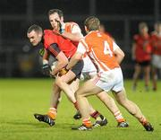 15 January 2011; Declan Sheeran, Down, in action against Jame Lavery and Paul Duffy, right, Armagh. Barrett Sports Lighting Dr. McKenna Cup, Section C, Down v Armagh, Pairc Esler, Newry, Co. Down. Picture credit: Oliver McVeigh / SPORTSFILE