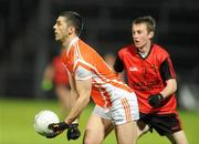 15 January 2011; Vincent Martin, Armagh, in action against Paul Devlin, Down. Barrett Sports Lighting Dr. McKenna Cup, Section C, Down v Armagh, Pairc Esler, Newry, Co. Down. Picture credit: Oliver McVeigh / SPORTSFILE