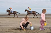 13 September 2016; Emily Maher, left, age 7, and her sister Lilly, age 2, from Laytown, Co Meath, play in the sand during the Laytown Races in Laytown, Co Meath. Photo by David Maher/Sportsfile