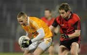 19 January 2011; Paddy Cunningham, Antrim, in action against Kevin Duffin, Down. Barrett Sports Lighting Dr. McKenna Cup, Section C, Antrim v Down, Casement Park, Belfast, Co. Antrim. Picture credit: Oliver McVeigh / SPORTSFILE