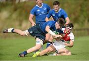 17 September 2016; Ruadhan Byron of Leinster is tackled by Tim Savoury of Ulster during the U18 Schools Interprovincial Series Round 3 match between Ulster and Leinster at Methodist College in Belfast.  Photo by Oliver McVeigh/Sportsfile