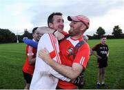 17 September 2016; Kieran Walsh of Dundrum, left, celebrates with a supporter after winning the cup final during the Volkswagen Junior Football 7s at St Judes GAA Club, Wellington Lane, Dublin.  Photo by Sam Barnes/Sportsfile