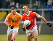 23 January 2011; Vincent Martin, Armagh, in action against Paddy Cunningham, Antrim. Barrett Sports Lighting Dr. McKenna Cup Section A, Armagh v Antrim, Athletic Grounds, Armagh. Picture credit: Michael Cullen / SPORTSFILE