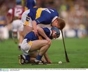 9 September 2001; Tipperary's Declan Ryan (14) helps Eoin Kelly up onto his feet. Tipperary v Galway, All Ireland Senior Hurling Final, Croke Park, Dublin. Picture credit; Brendan Moran / SPORTSFILE