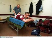 12 September 2001; Galway's Alan Kerins is given some treatment by Galway team physio Seamus McWalter. Galway football squad training, Tuam Stadium, Tuam, Co. Galway. Picture credit; Damien Eagers / SPORTSFILE